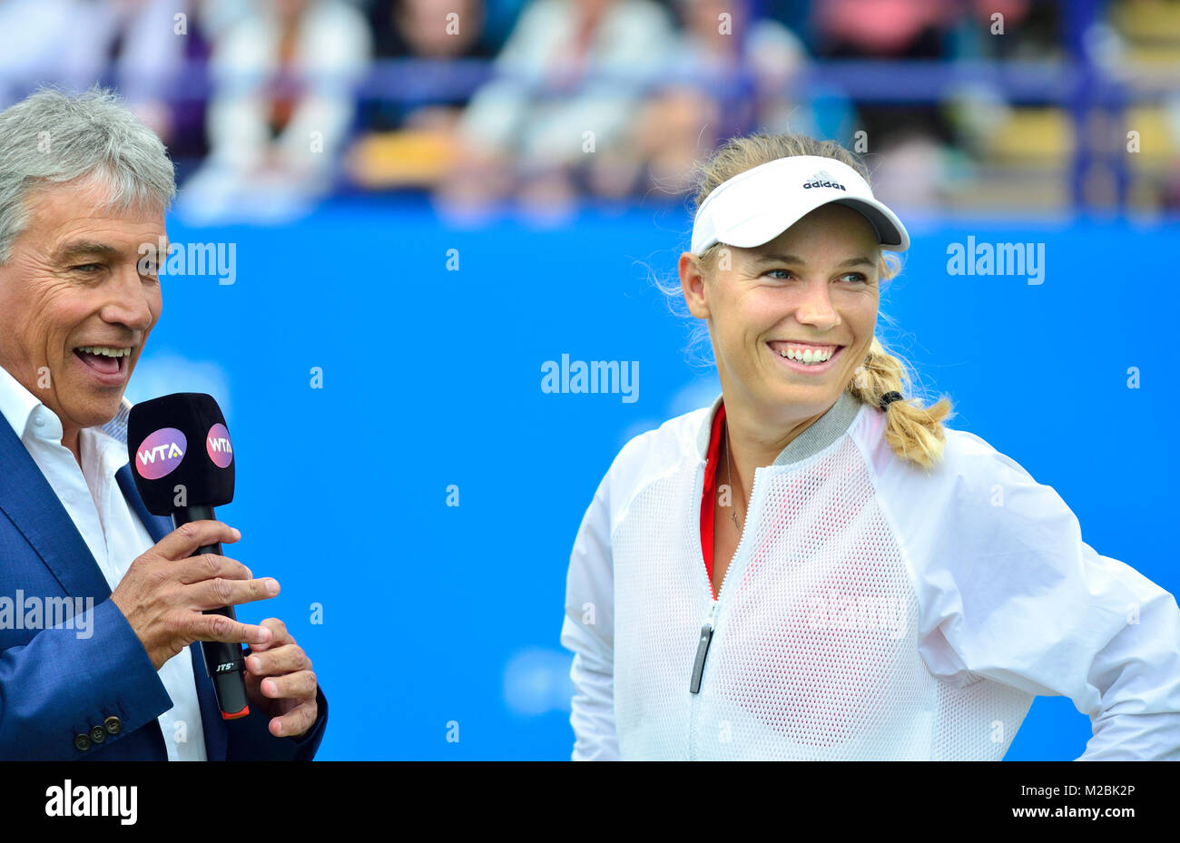 Caroline Wozniacki (Denmark) interviewed by John Inverdale for the BBC after the final of the Aegon International, - Stock Image