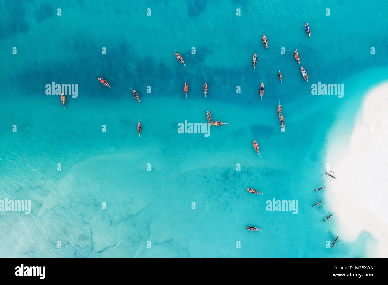 Aerial view of wooden fisherman boats and white sandy beach at Kendwa village, Zanzibar - Stock Image