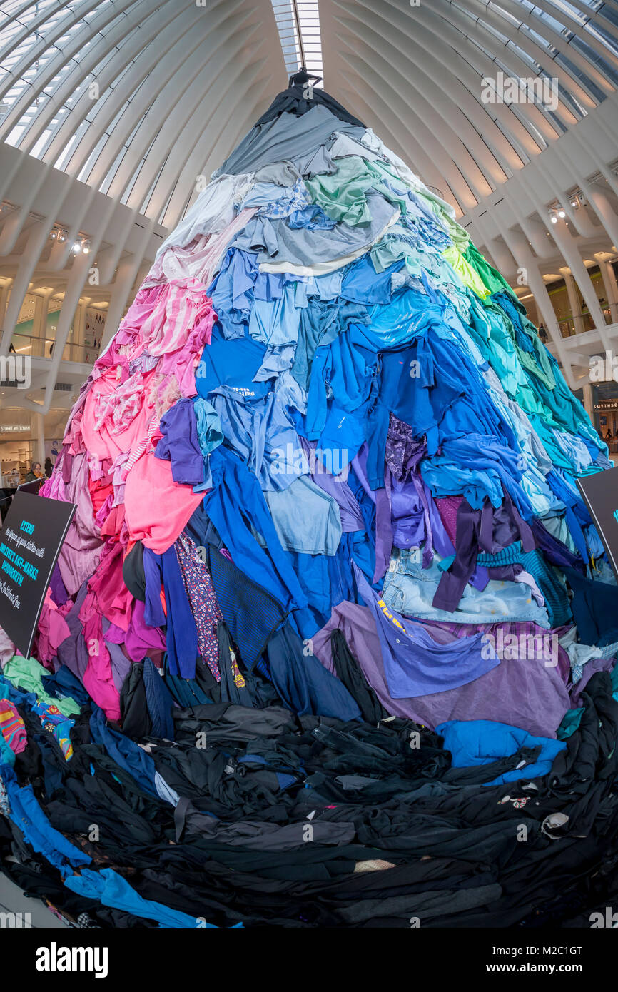 A 26 foot-tall installation comprised of thousands of articles of used clothing is seen in the Oculus of Westfield - Stock Image