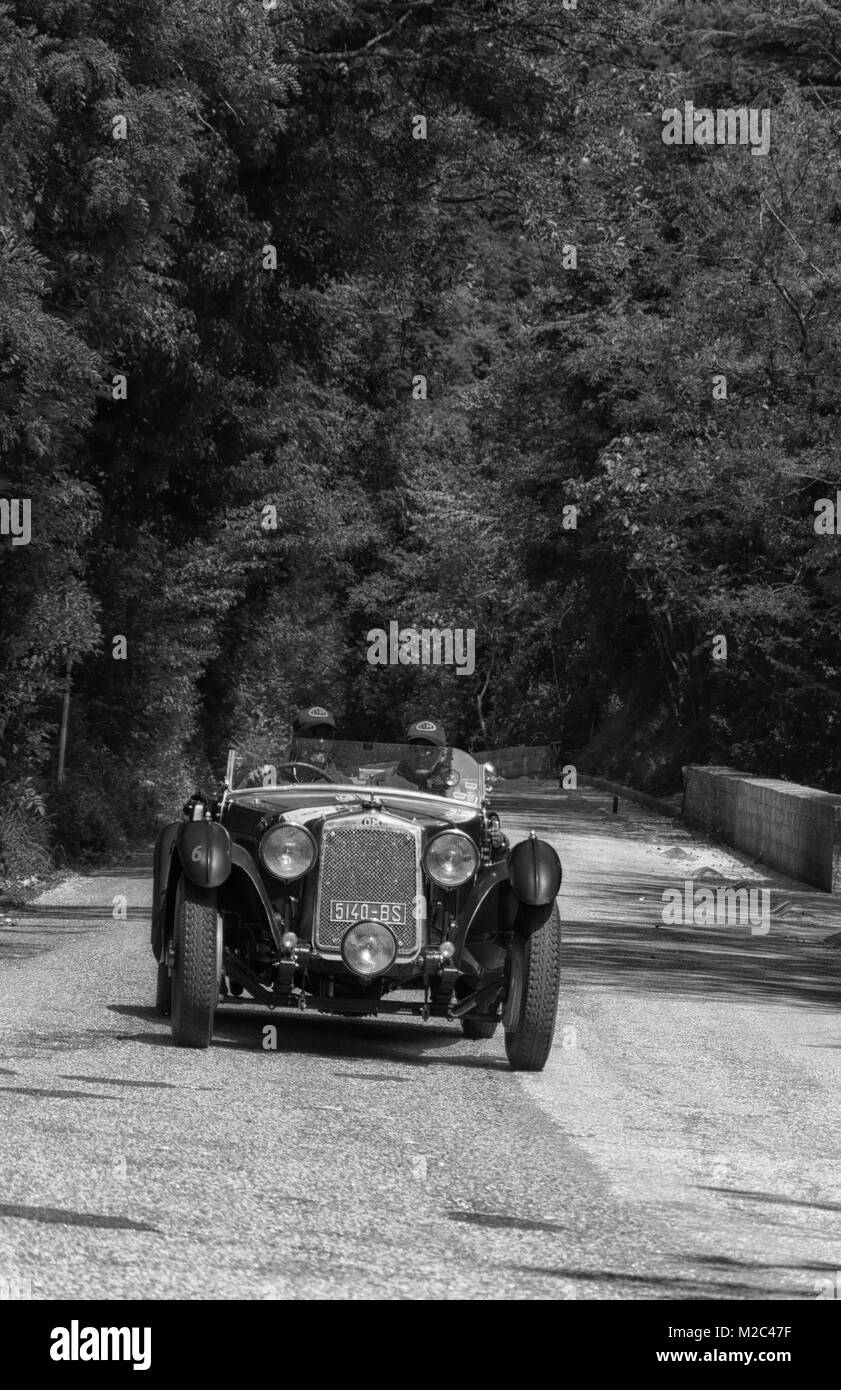 GOLA DEL FURLO, ITALY - MAY 19: O.M. 665 SS MM 1929on an old racing car in rally Mille Miglia 2017 the famous italian - Stock Image