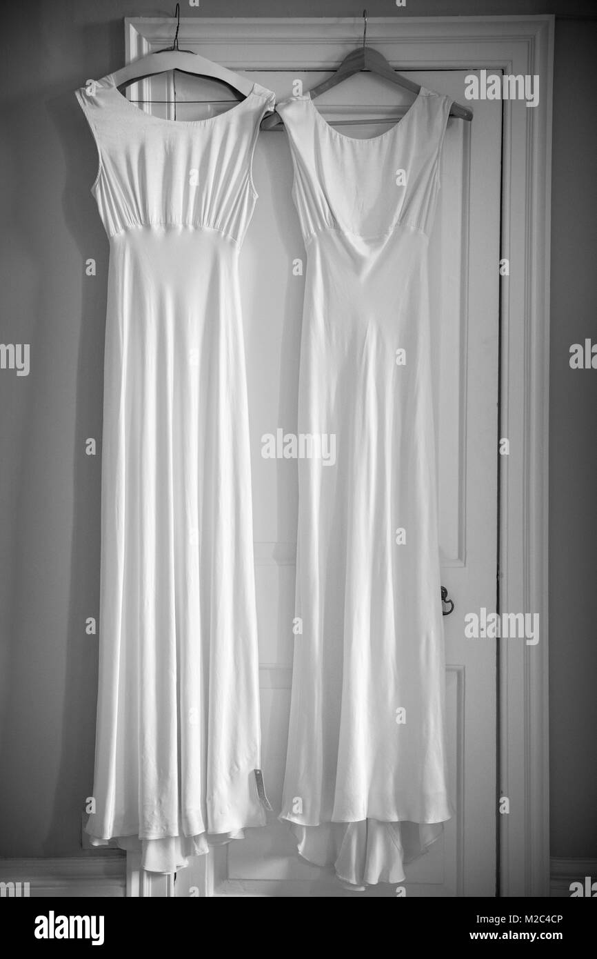 Two wedding dresses hanging on door frame Stock Photo: 173599910 - Alamy