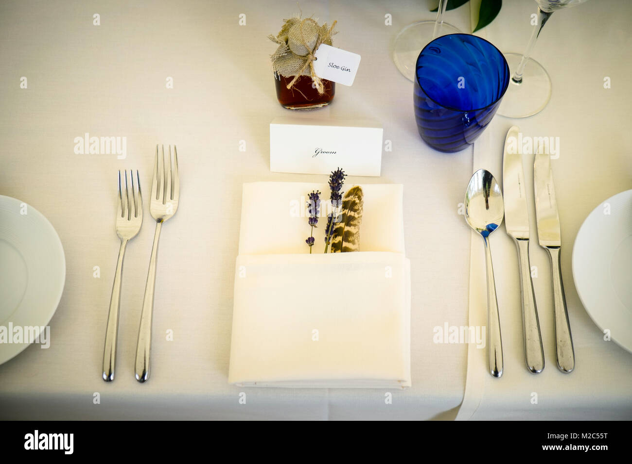 Napkin place setting on table, with place card and wedding favour ...