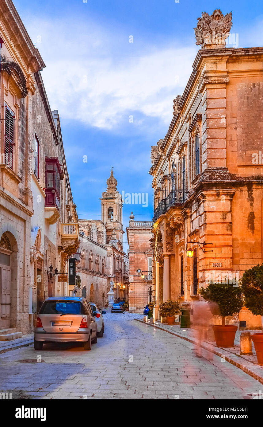Victoria, Gozo, Malta: Narrow streets of the citadella at the sunset time. - Stock Image