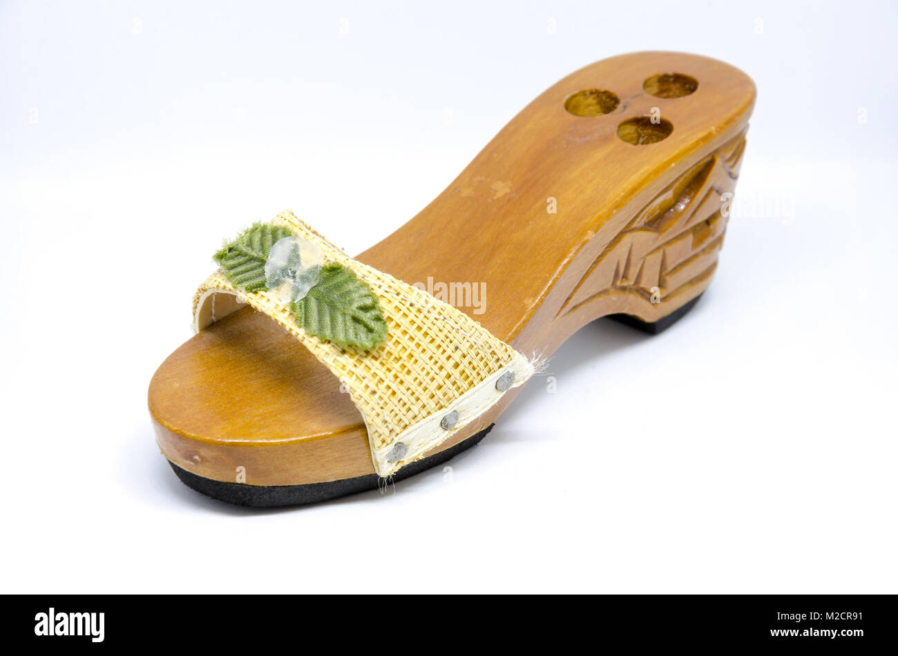A decorative pen holder in the form of a ladiy's shoe. - Stock Image