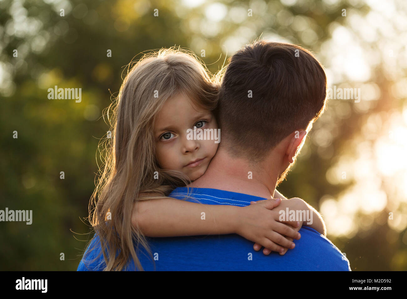 Boy Hugging Girl In Arms