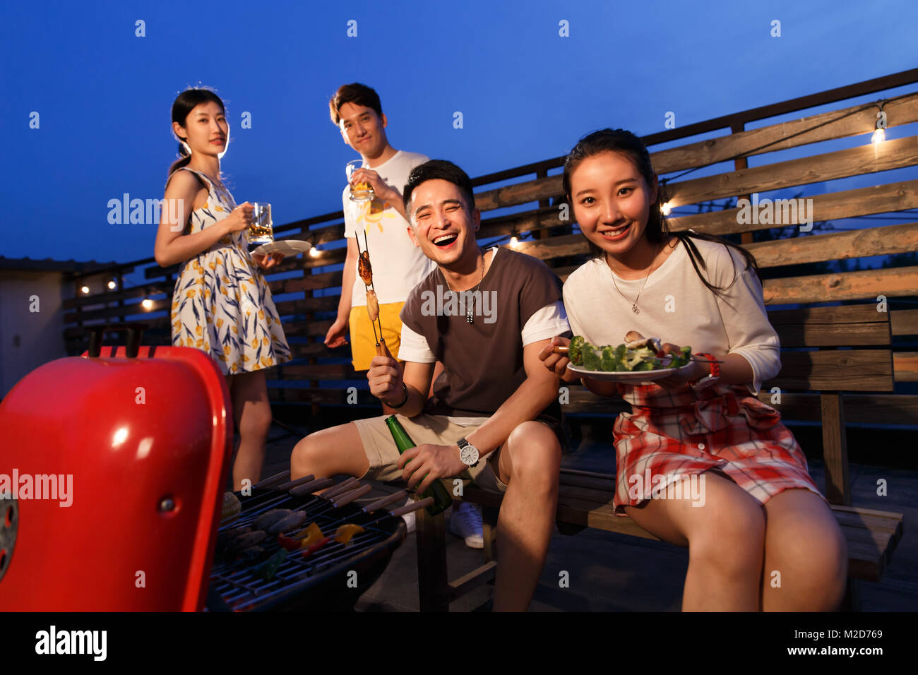 The young people have a picnic Stock Photo