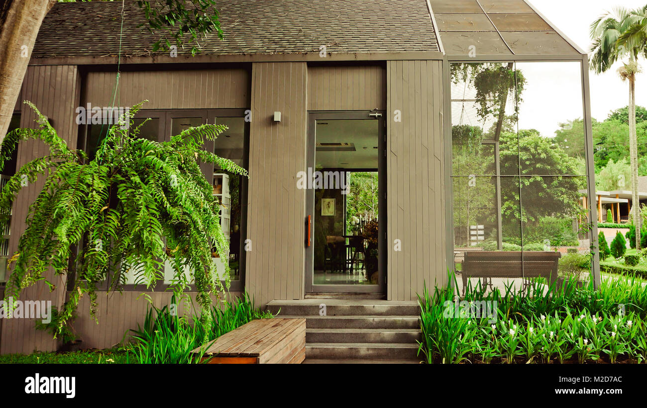 The garden is decorated in tropical jungle style for relaxation. Stock Photo