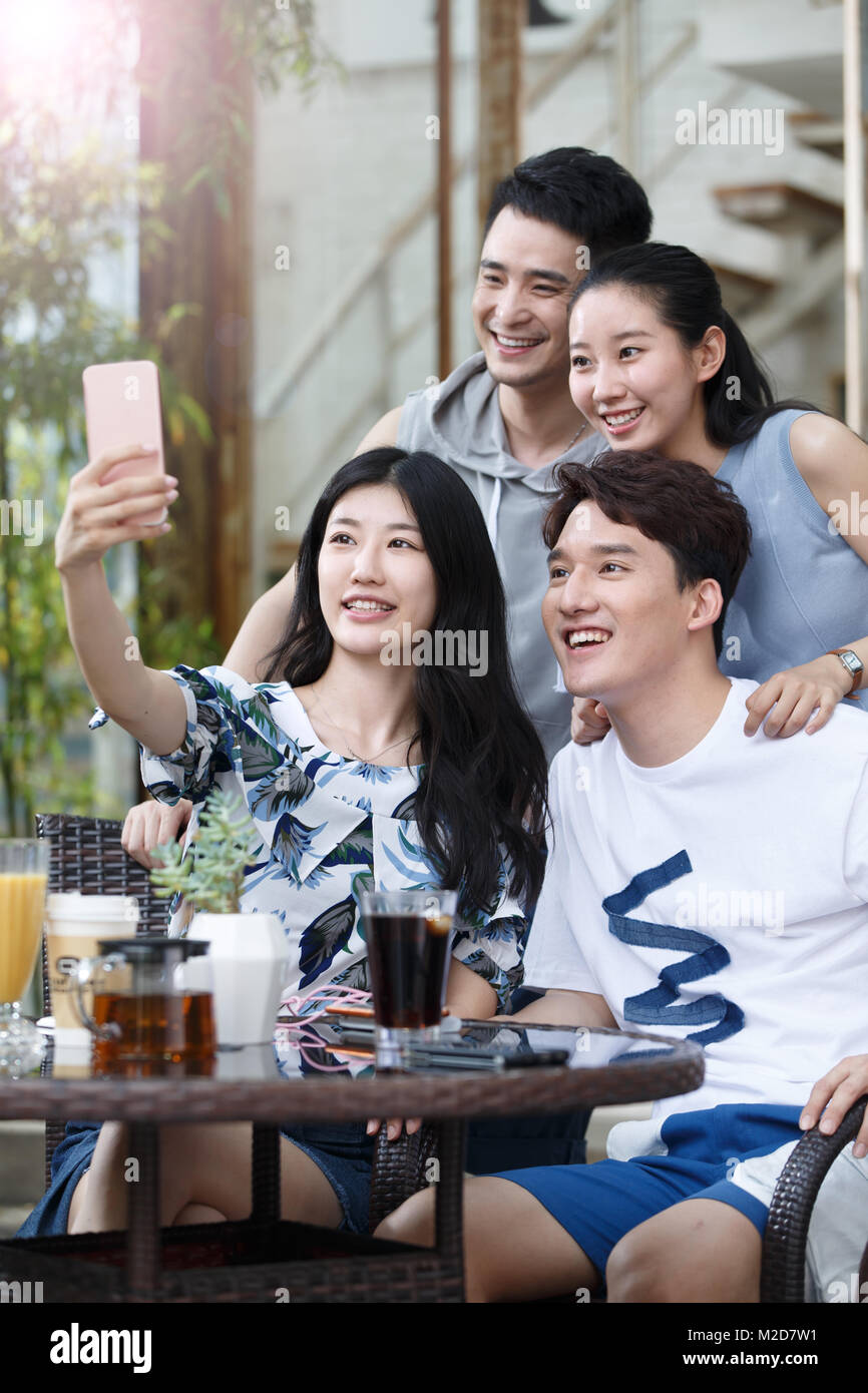 Young people take pictures with their cell phones Stock Photo