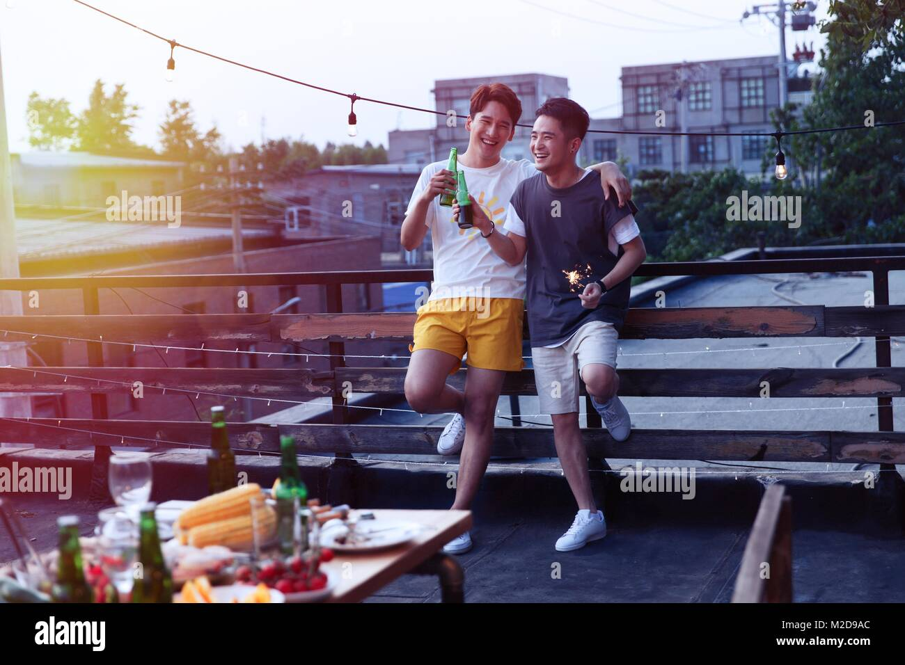 Two young men drank beer - Stock Image