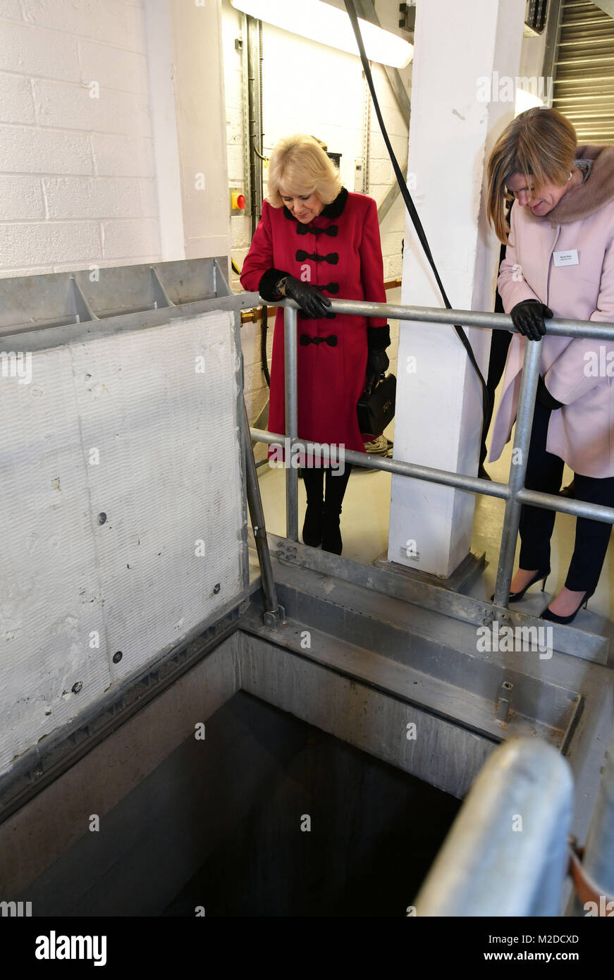 The Duchess of Cornwall inspects the shaft that goes down to the tunnels during the official opening The National - Stock Image