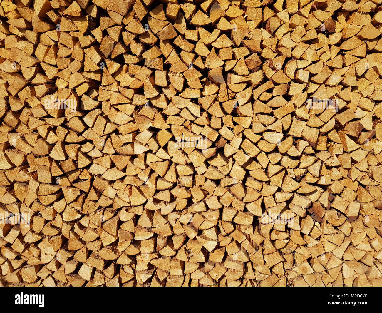 Cut and stacked a lot of firewood pieces as background. Stock Photo