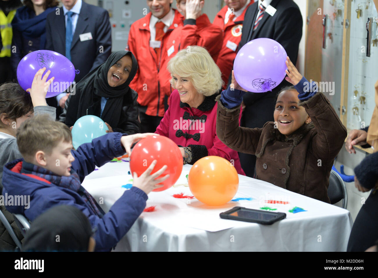 The Duchess of Cornwall with children learning about static electricity during the official opening The National - Stock Image