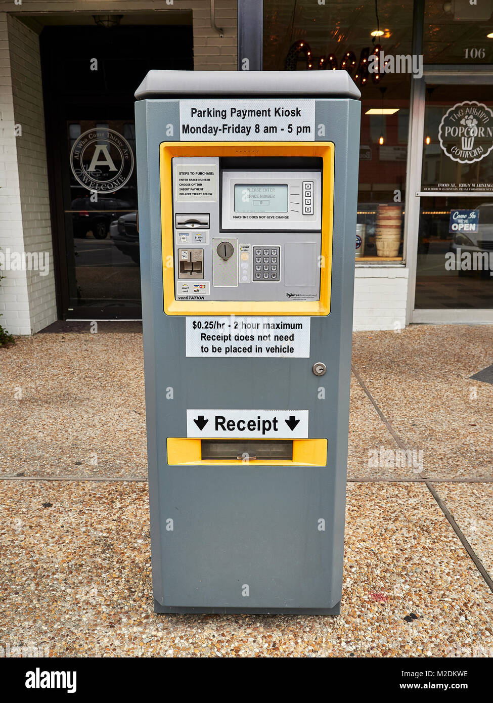 Parking payment kiosk or parking meter, on a city street, used to pay for street parking in Auburn Alabama, USA. - Stock Image