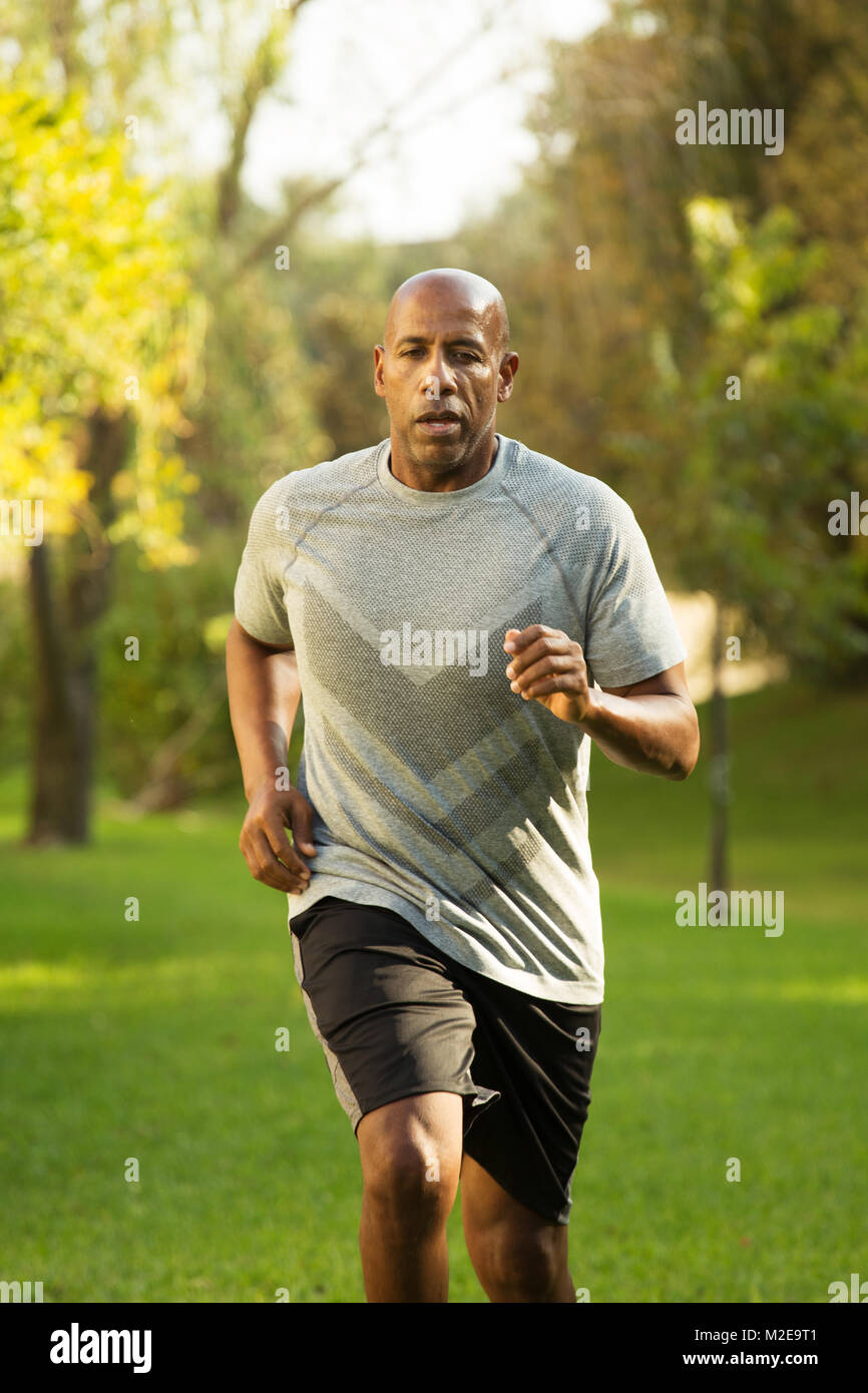 Fit African American man running. - Stock Image