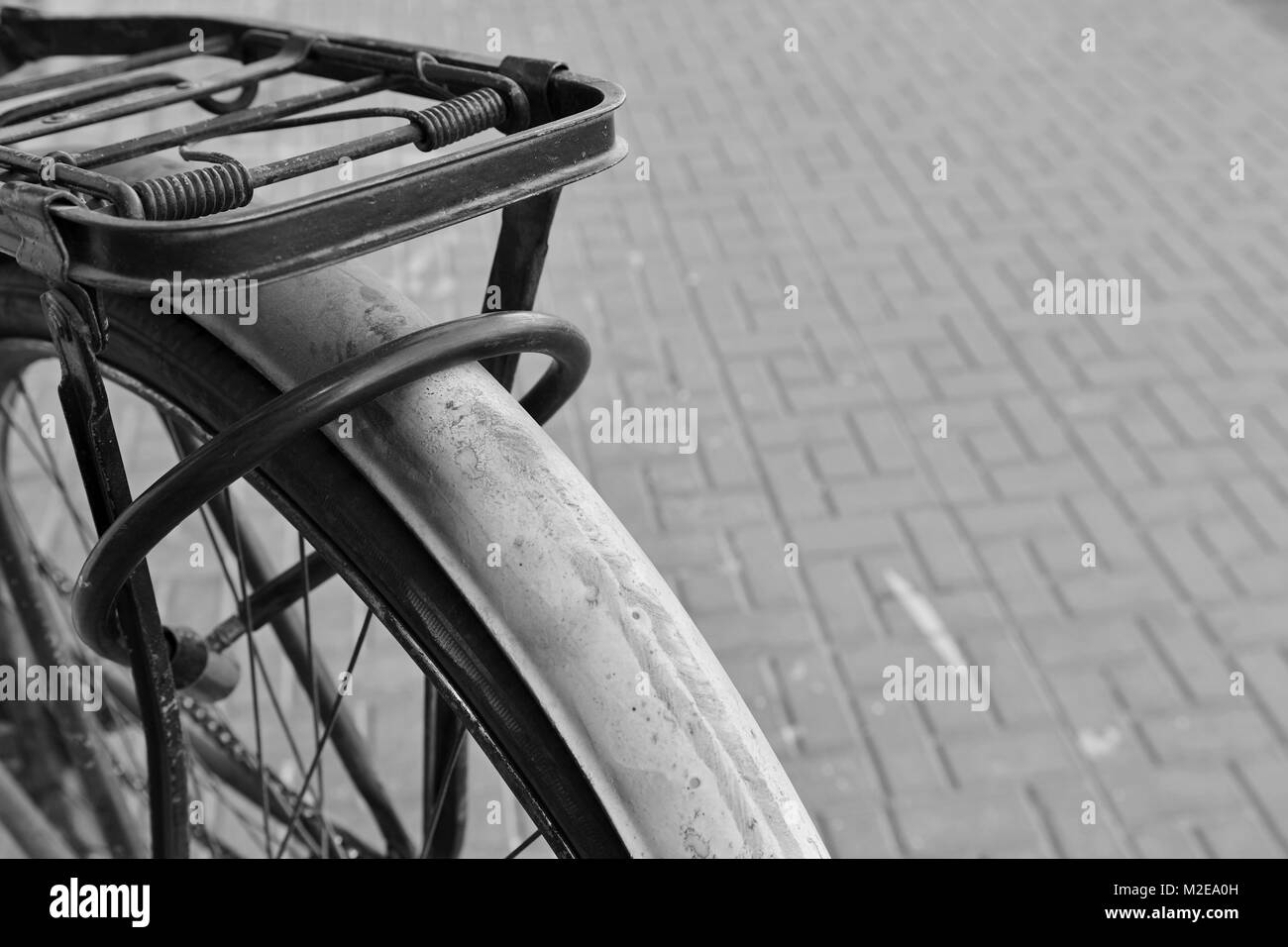 bicycle in b&w parked on the street - Stock Image