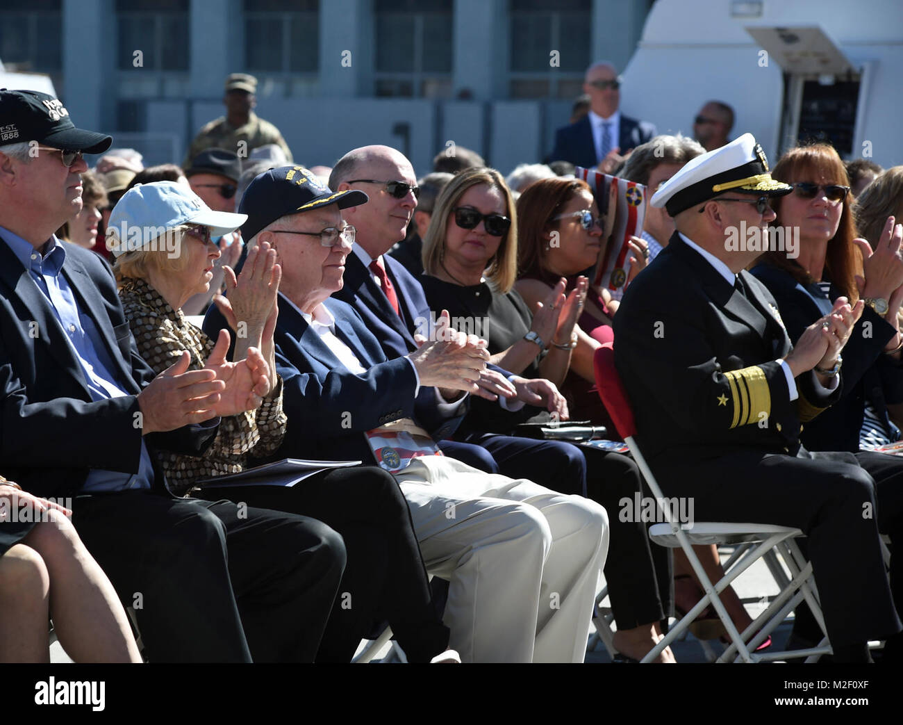 SAN DIEGO (Feb. 3, 2018) Warren Buffett, center, and his wife Astrid Menks, left of him, clap during the commissioning - Stock Image