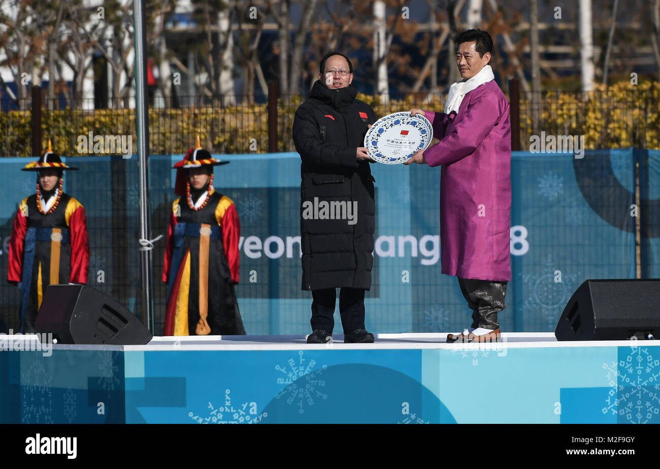Pyeongchang, South Korea. 7th Feb, 2018. Gou Zhongwen (L, front), head of Chinese delegation and director of China's Stock Photo