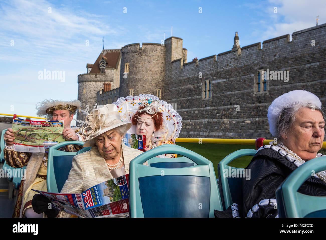 Windsor, UK. 7th February, 2018. Actors playing King Henry VIII, Queen Elizabeth I, Queen Victoria and Queen Elizabeth - Stock Image