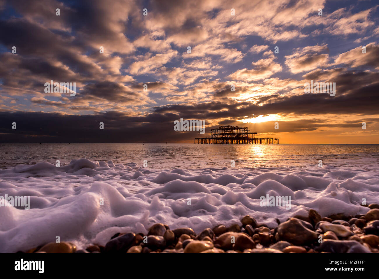 Brighton, UK. 7th Feb, 2018. UK Weather: The abandoned West Pier in Brighton at sunset this evening Credit: Andrew - Stock Image