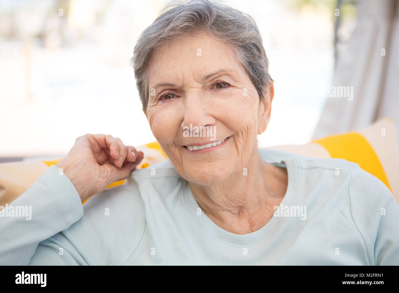 Portrait of a mature elderly woman smiling. - Stock Image