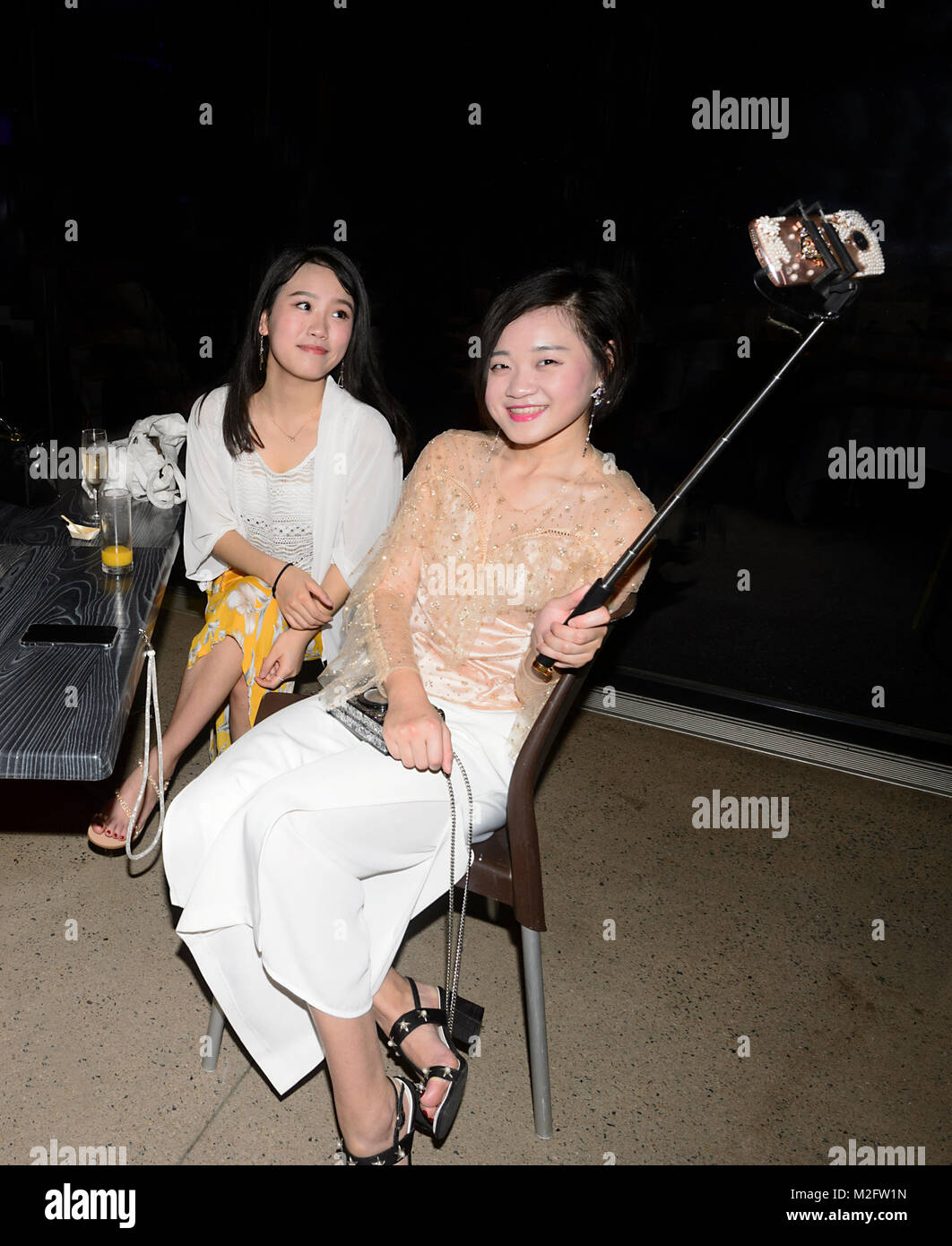 Young Chinese women tourists taking a selfie, Australia Stock Photo