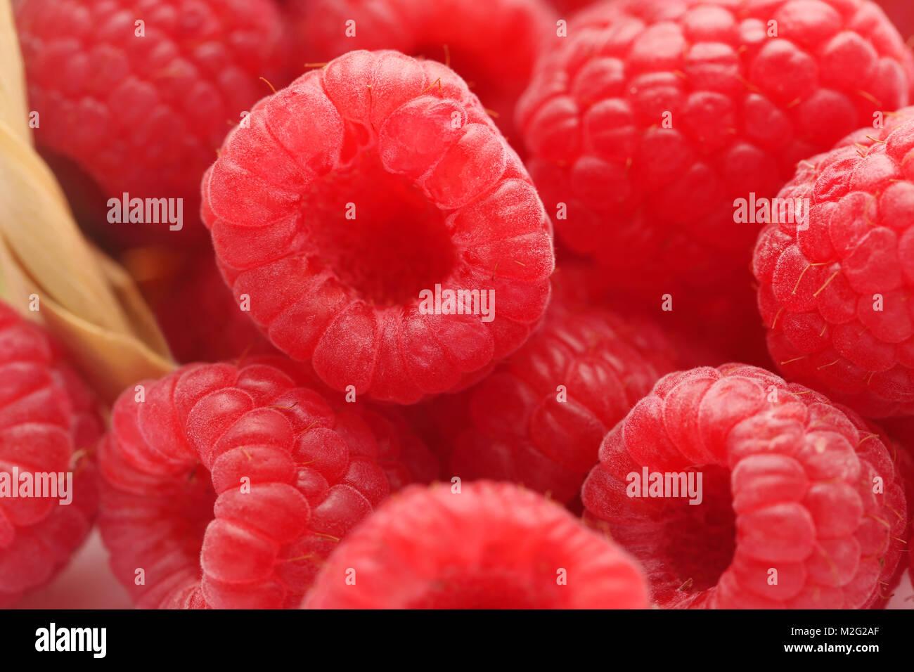 Closeup of some fresh raspberries - Stock Image