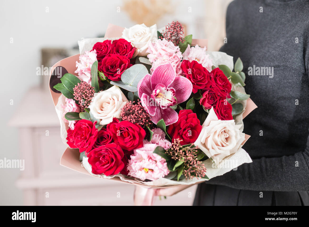 beautiful luxury bouquet of mixed flowers in woman hand. the work of ...