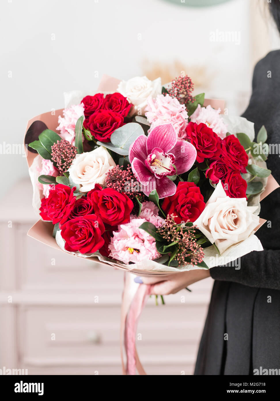 Beautiful luxury bouquet of mixed flowers in woman hand the work of beautiful luxury bouquet of mixed flowers in woman hand the work of the florist at a flower shop izmirmasajfo