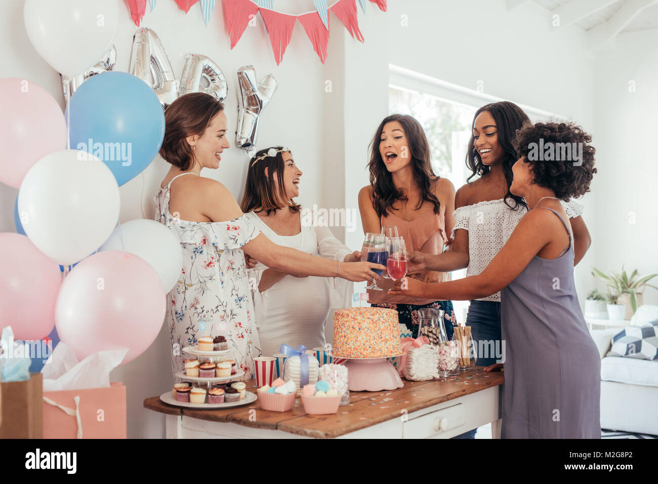 Women Toasting With Juices At Baby Shower Party Group Of Friends At Stock Photo Alamy