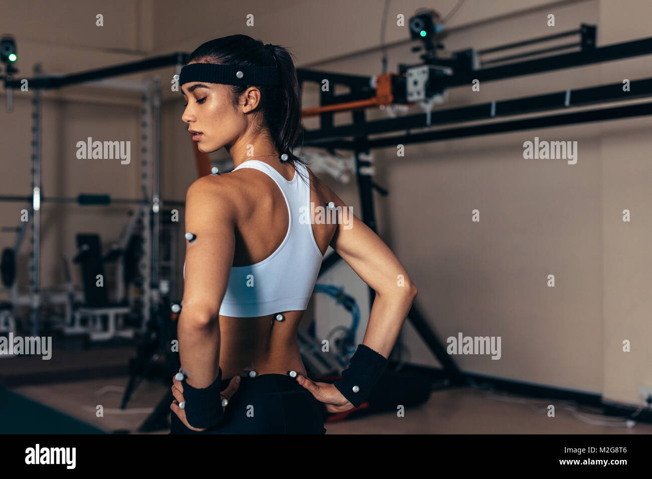 Sportswoman with motion capture sensors on her body to