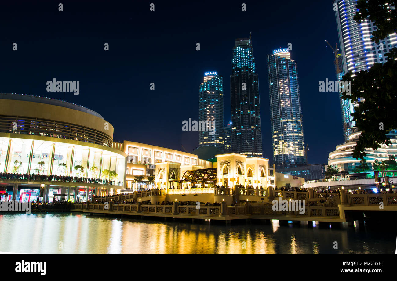 DUBAI, UNITED ARAB EMIRATES - FEBRUARY 5, 2018: Dubai mall building and neighboring skyscrapers reflected in the - Stock Image