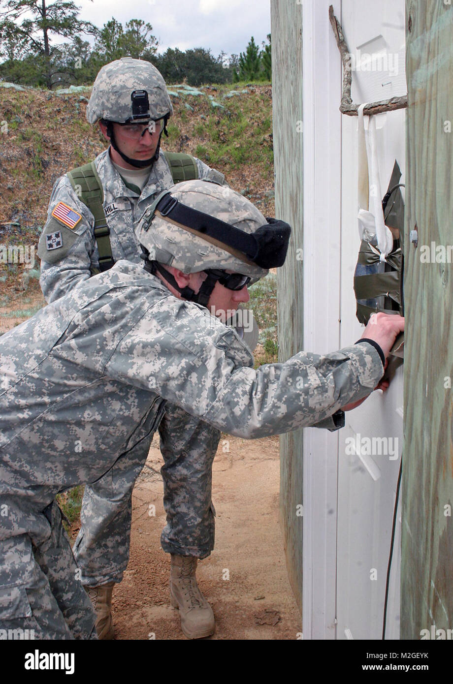 ADLC students do a final check of the door breaching charge by Georgia National Guard & ADLC students do a final check of the door breaching charge by Stock ...