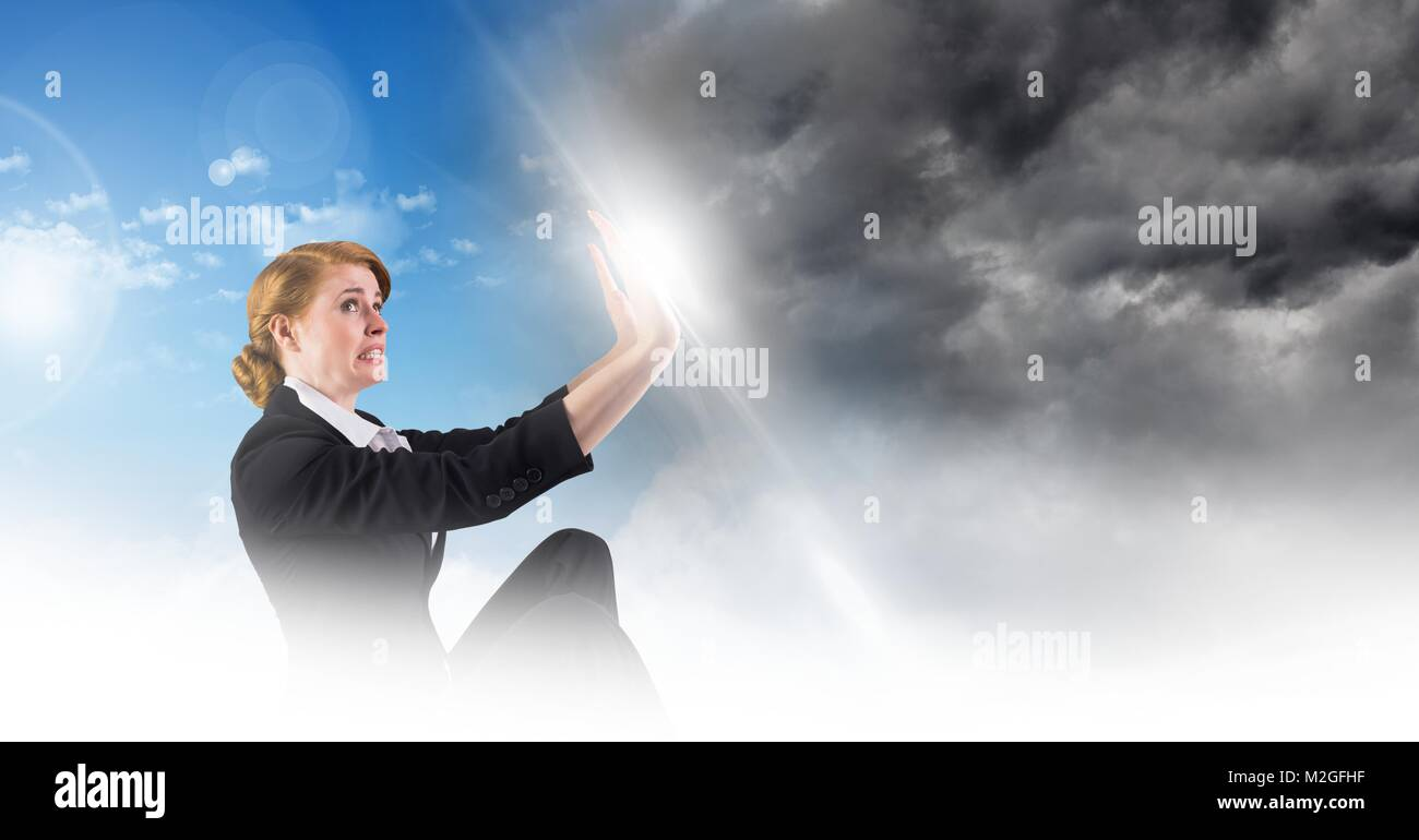 Woman blocking Grey sky and blue sky weather change surreal transition Stock Photo