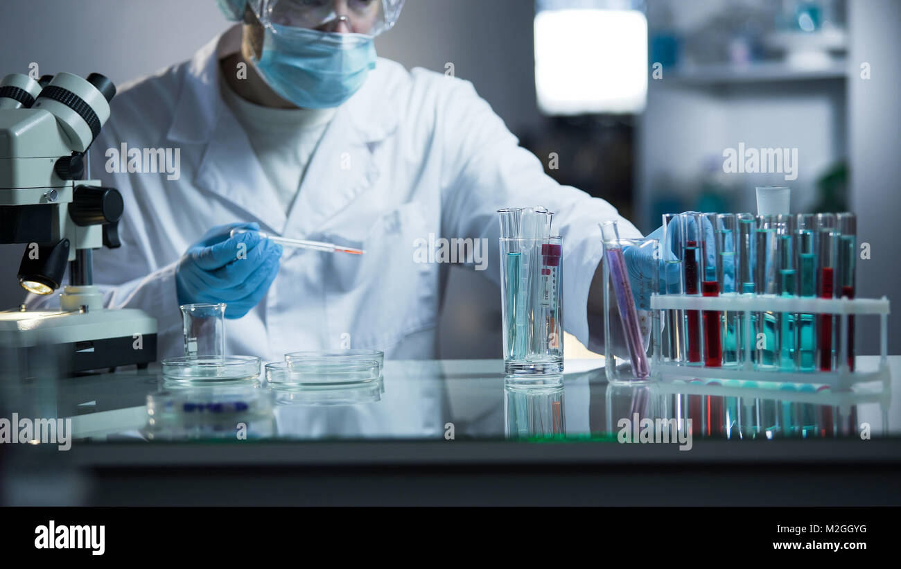 Medical lab assistant taking genetic material for examination on paternity, stock video - Stock Image