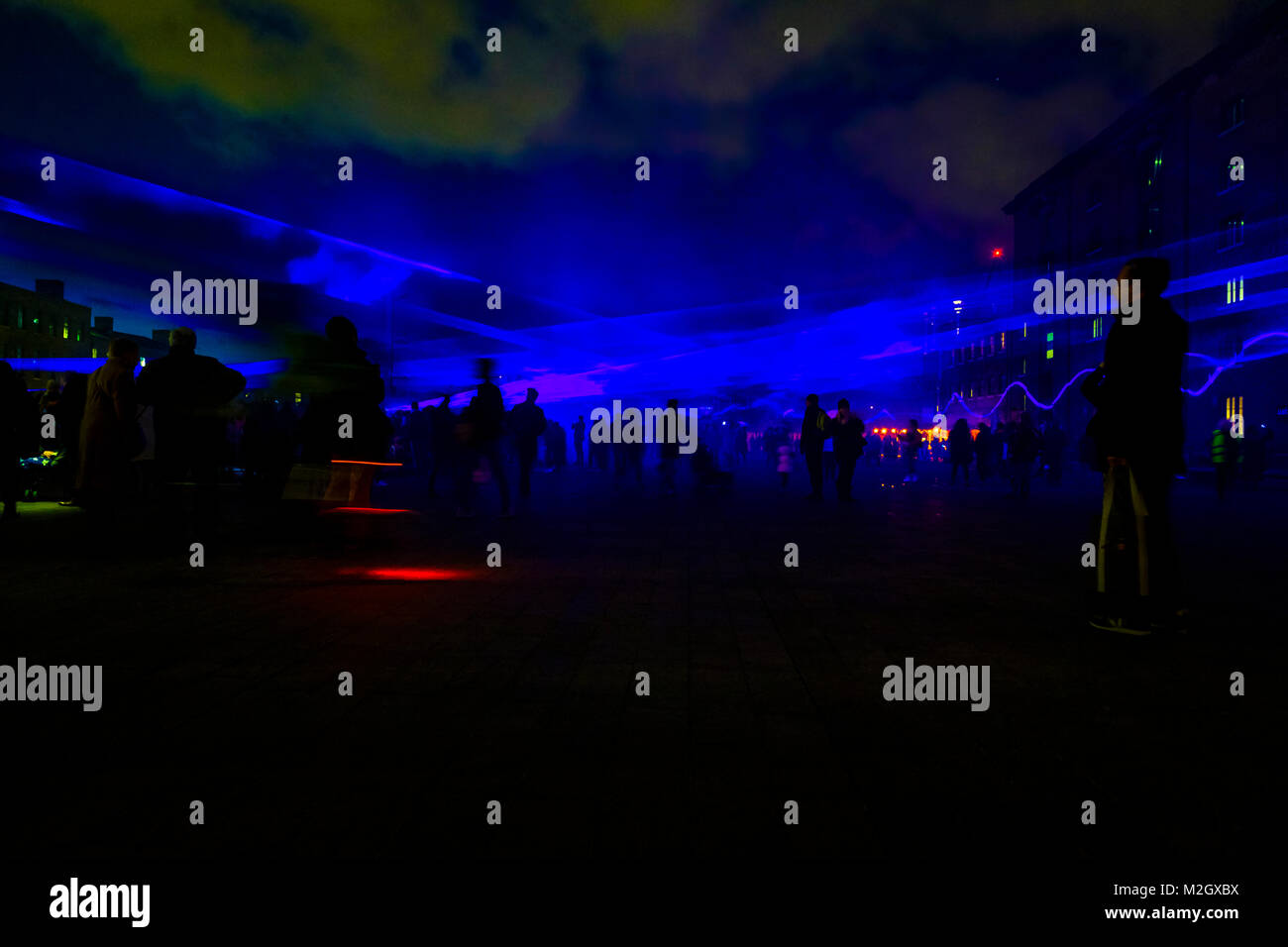 Crowds enjoy Daan Roosegaarde's Waterlicht - an installation within the Kings Cross Area of Lumiere London 2018 - Stock Image