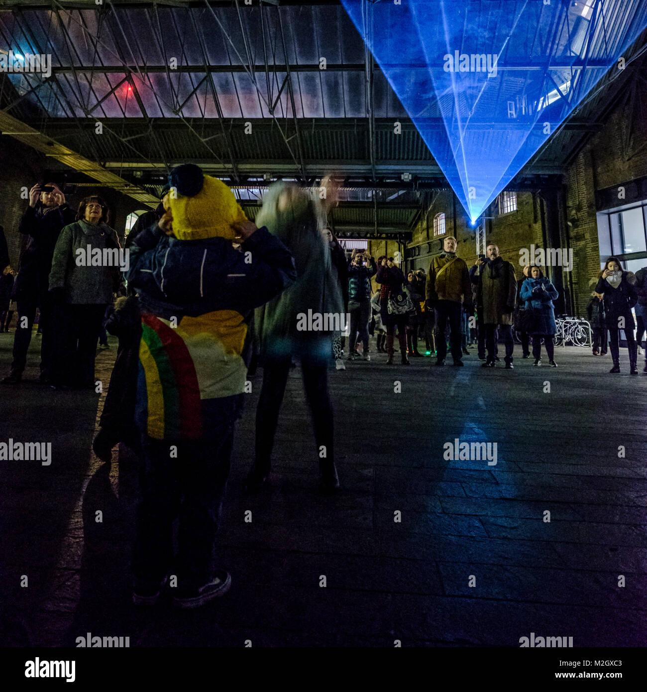 Crowds enjoy Aether by the Architecture Social Club with Max Cooper - an installation within the Kings Cross Area - Stock Image