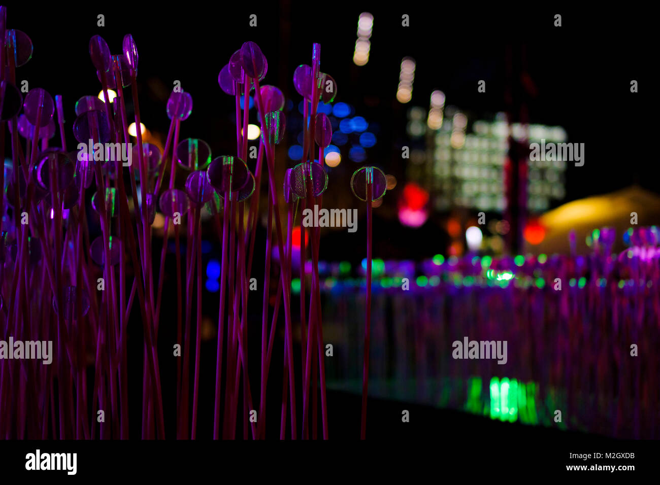 Crowds enjoy Entre les rangs by Rami Bebawi / KANVA - an installation within the Kings Cross Area of Lumiere London - Stock Image