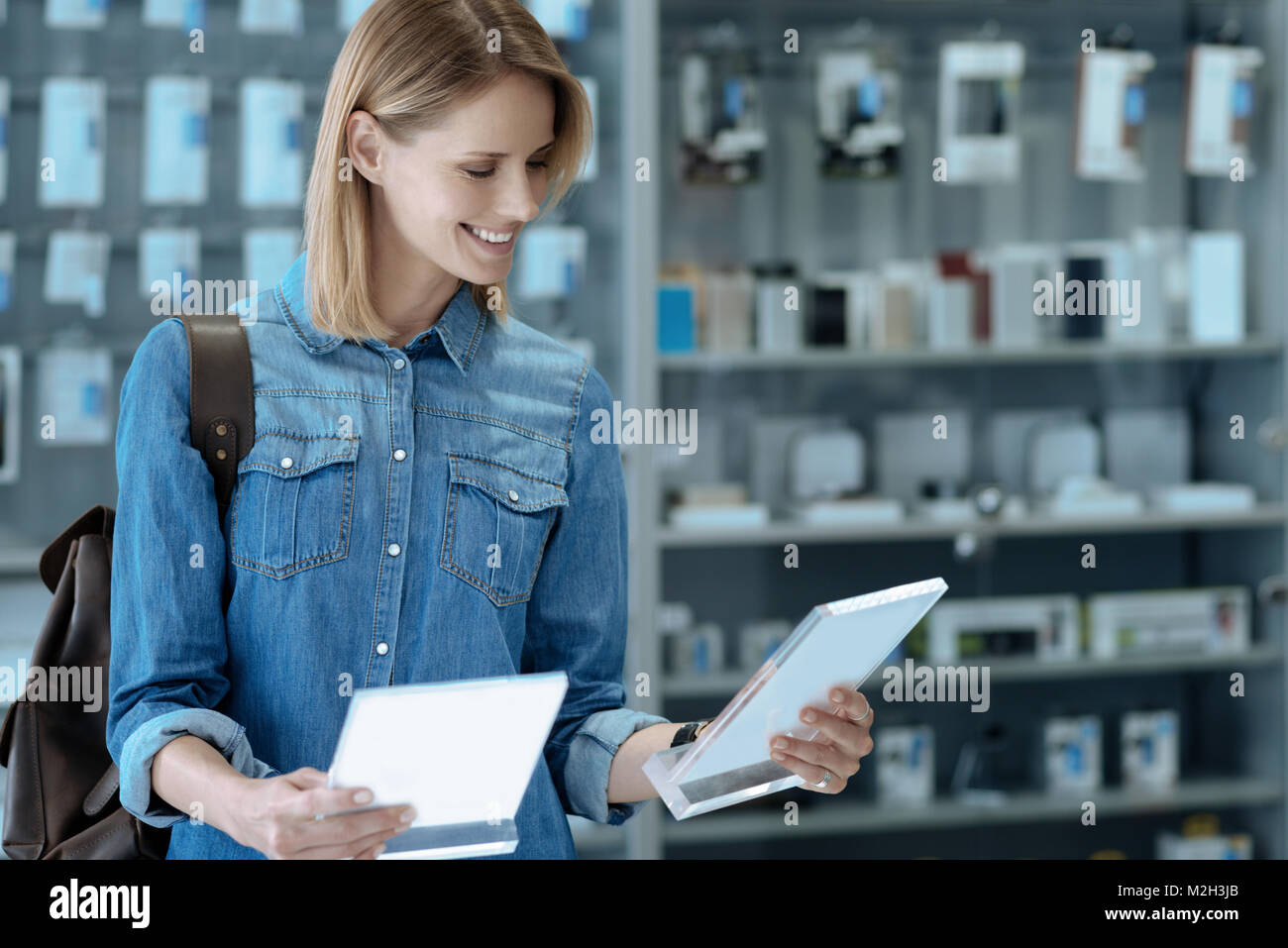 Cheerful woman holding two name boards - Stock Image