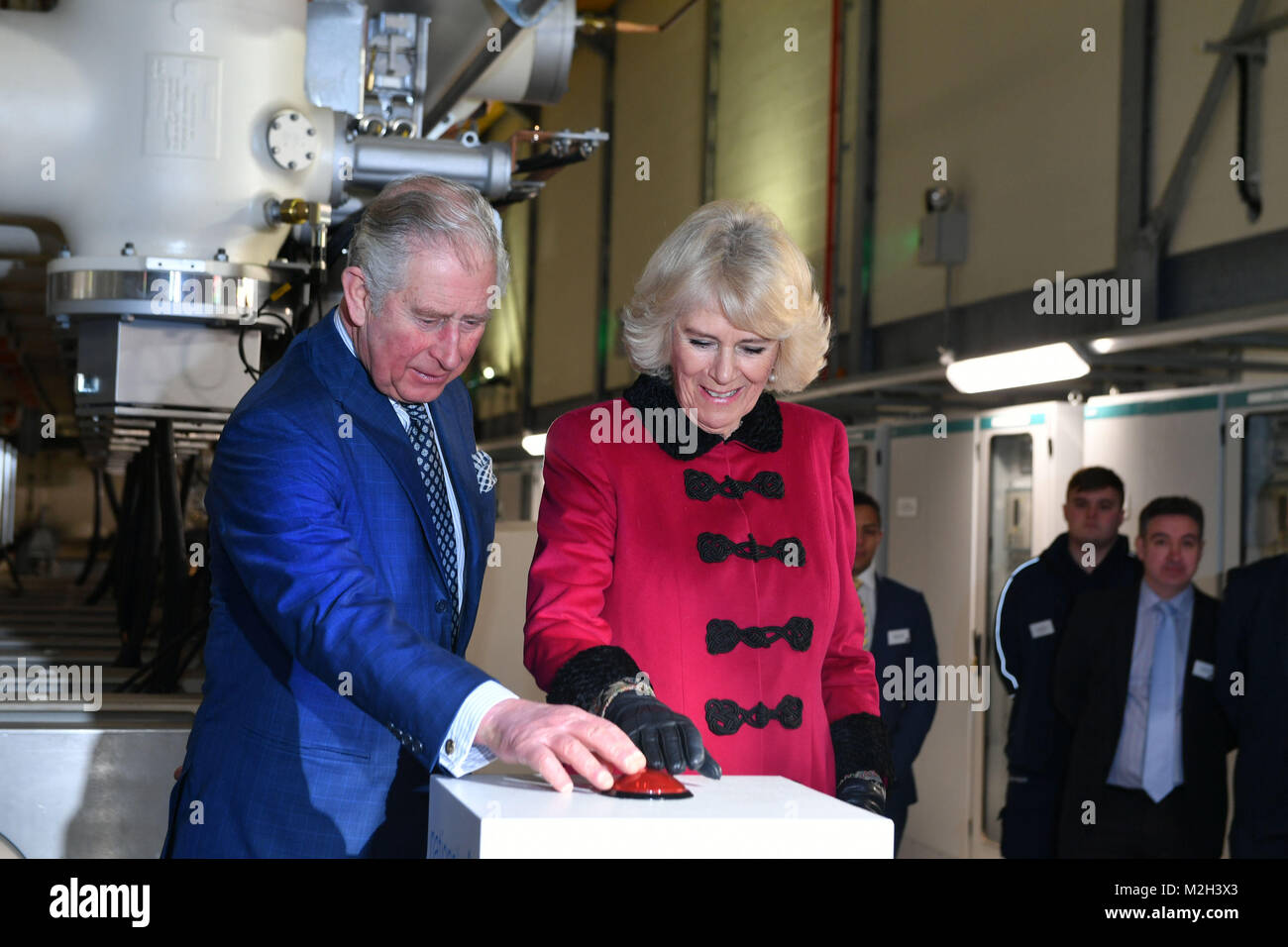 The Prince of Wales and Duchess of Cornwall press the start button during the official opening The National Grid's - Stock Image