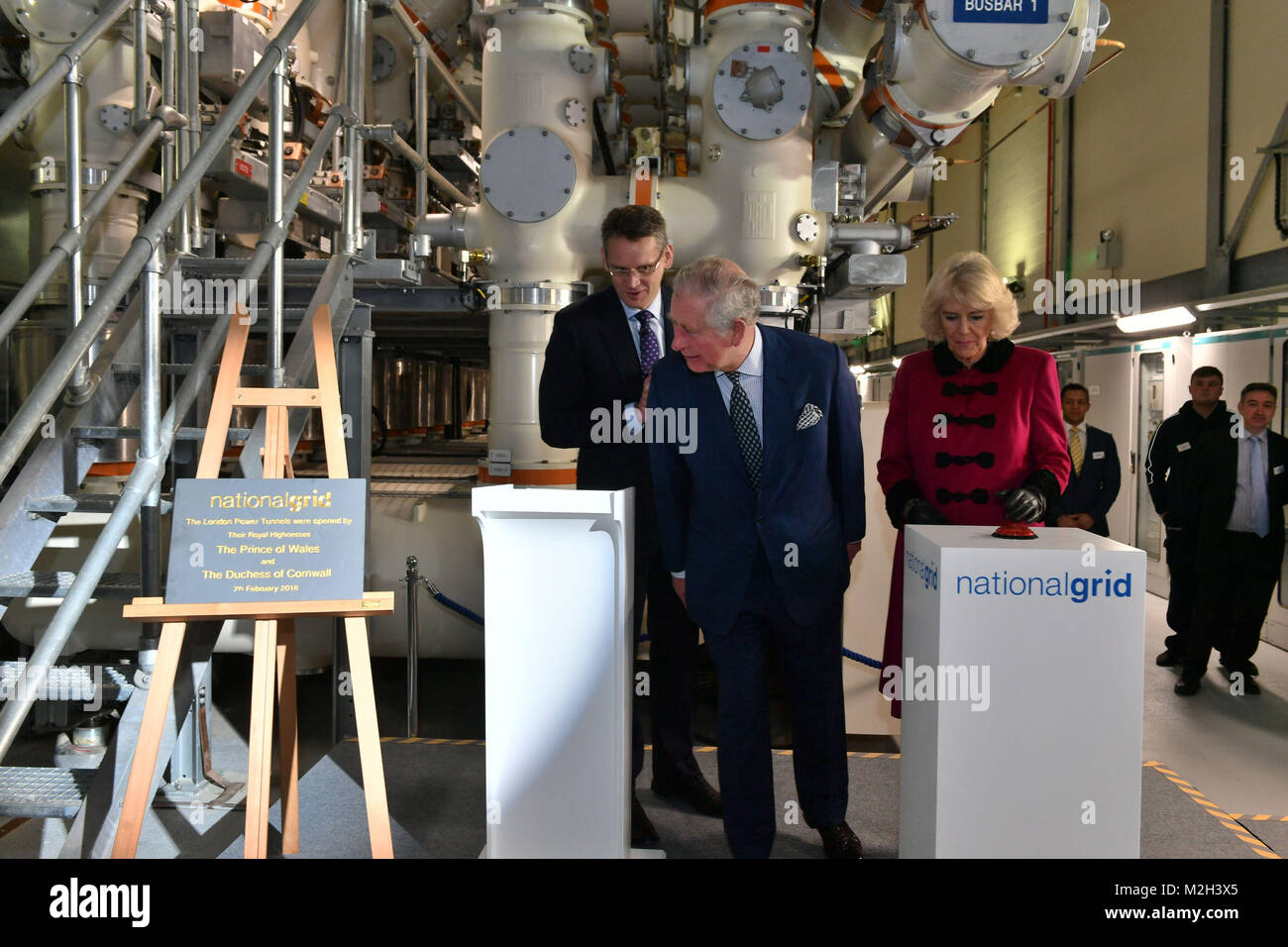 The Prince of Wales and Duchess of Cornwall after they pressed the start button during the official opening The - Stock Image