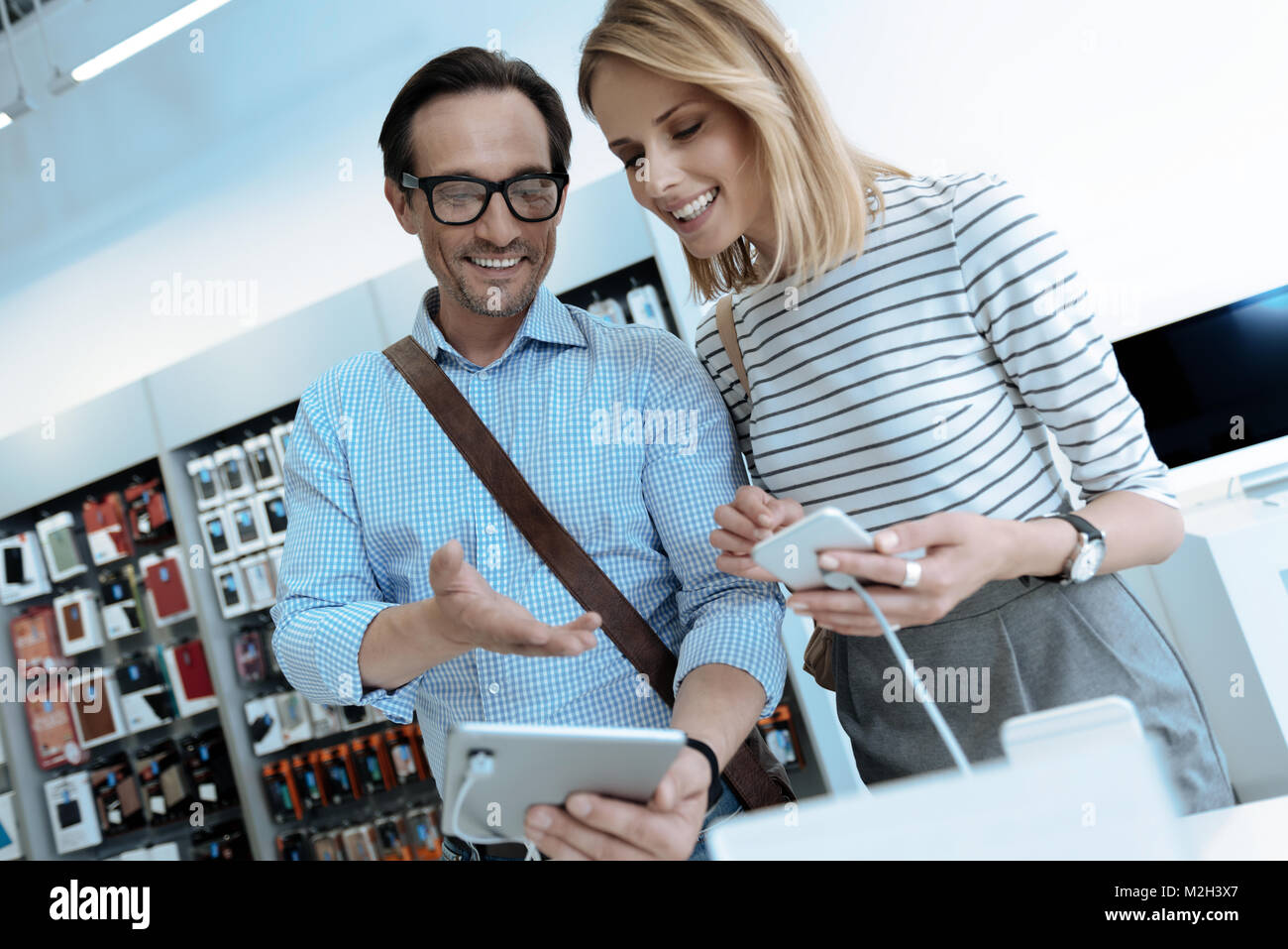 Attentive blonde female listening to her partner - Stock Image