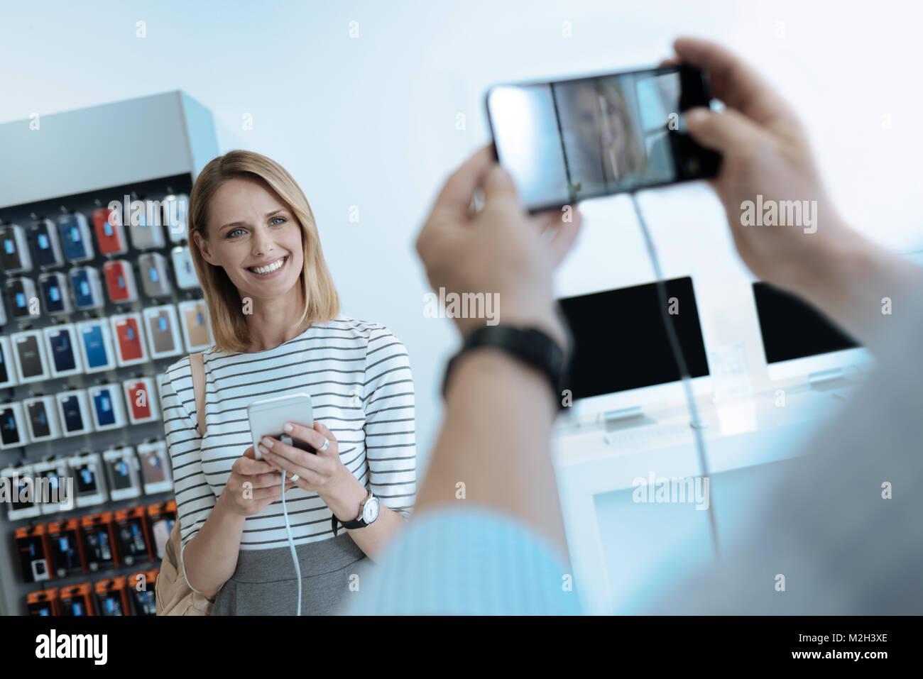 Amazing blonde demonstrating her smile - Stock Image