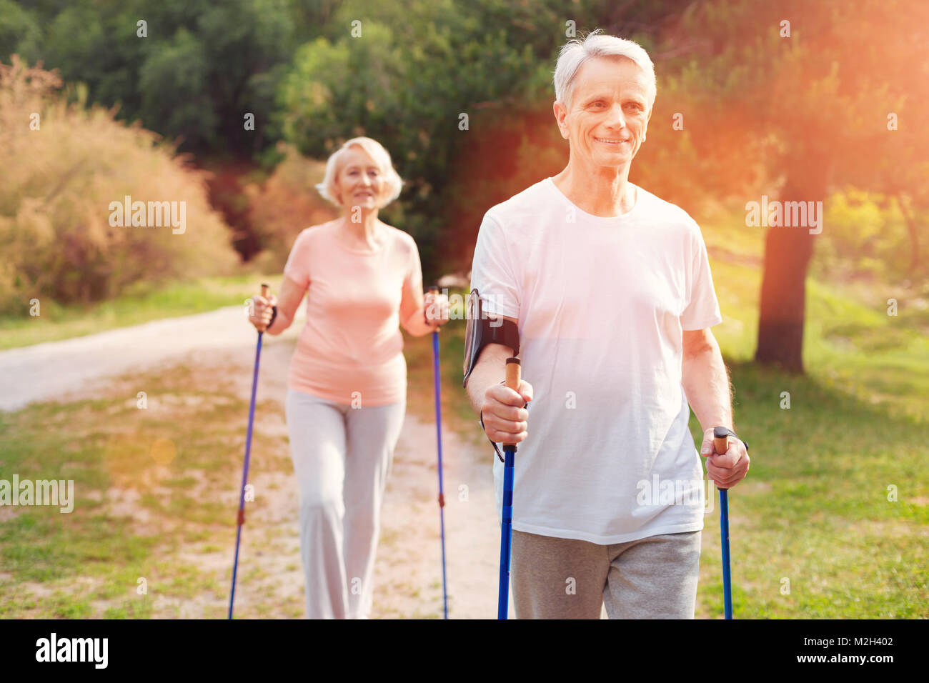 Positive elderly couple resting outdoors - Stock Image