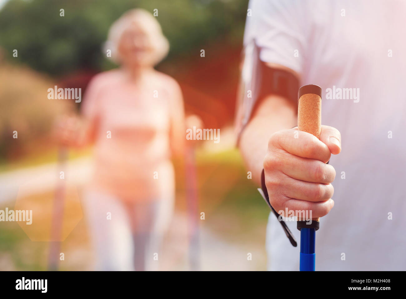 Close up of elderly man holding a crutch - Stock Image