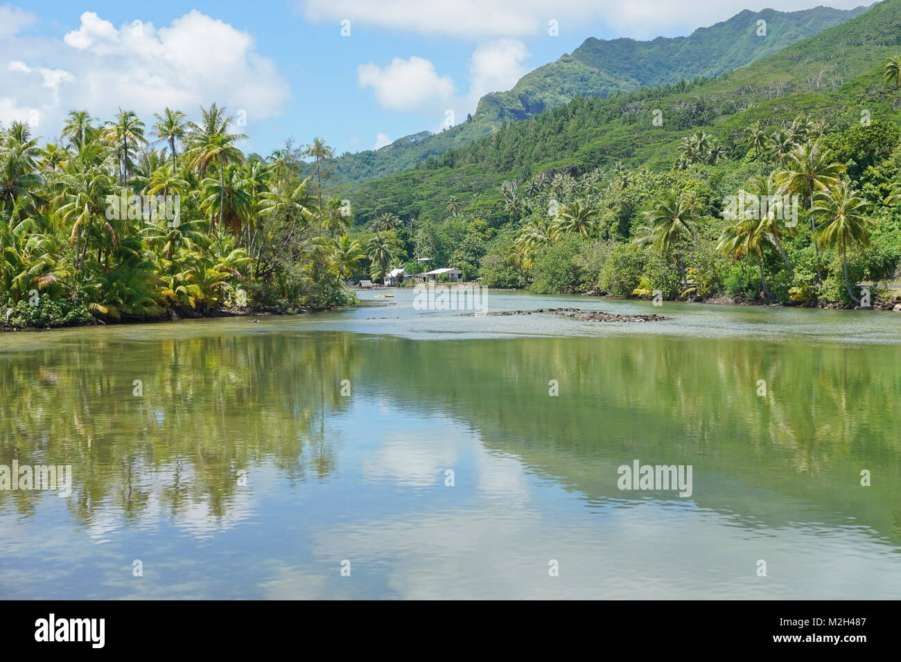 A channel with stone fish trap between the lake Fauna nui and the ocean, island of Huahine, South Pacific, French - Stock Image