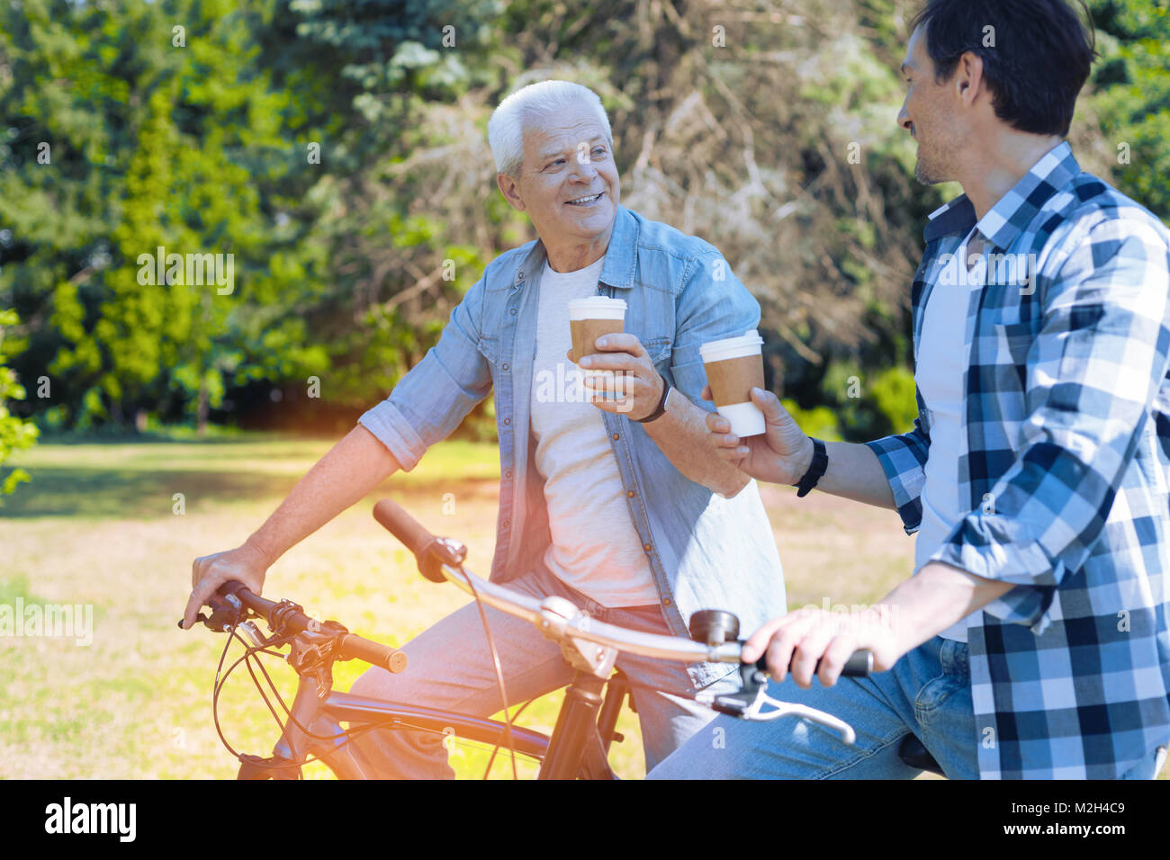 Relaxed father and son spending time together - Stock Image