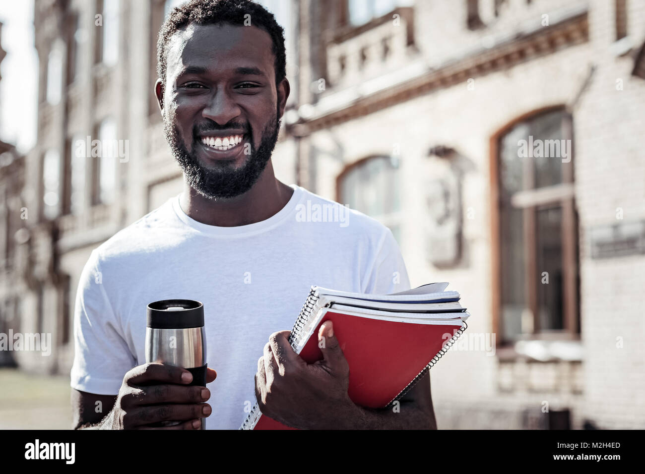 Cheerful delighted man looking at you - Stock Image