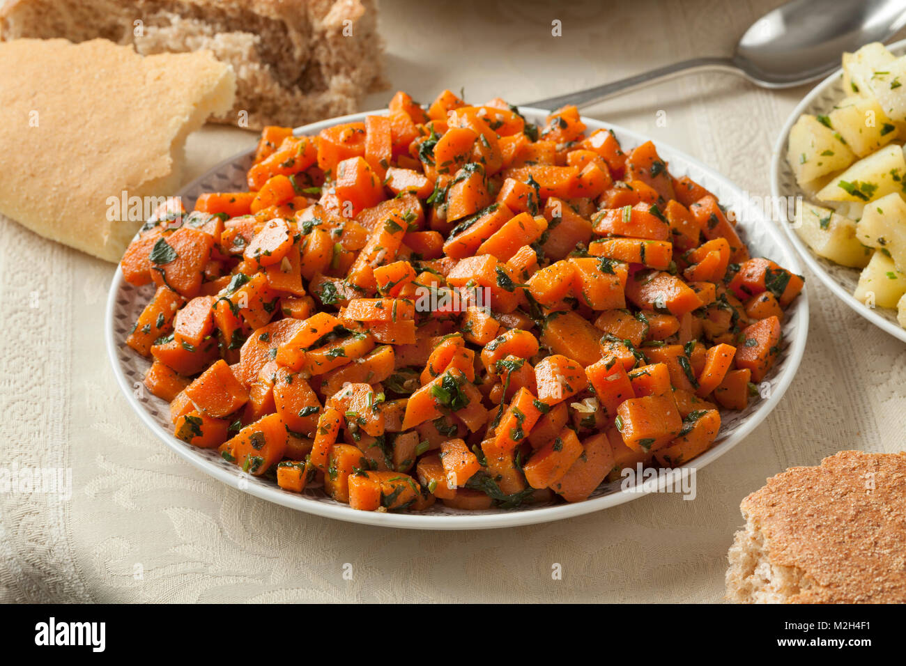 Traditional Moroccan carrot salad as a side dish - Stock Image