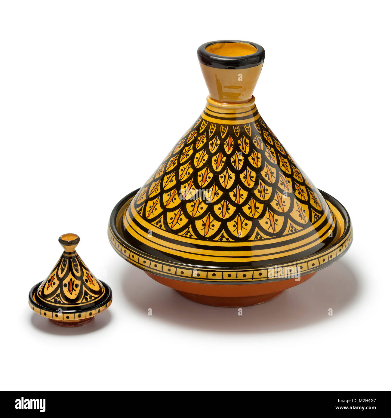 Moroccan handmade decorated large and small tagine isolated  on white background - Stock Image