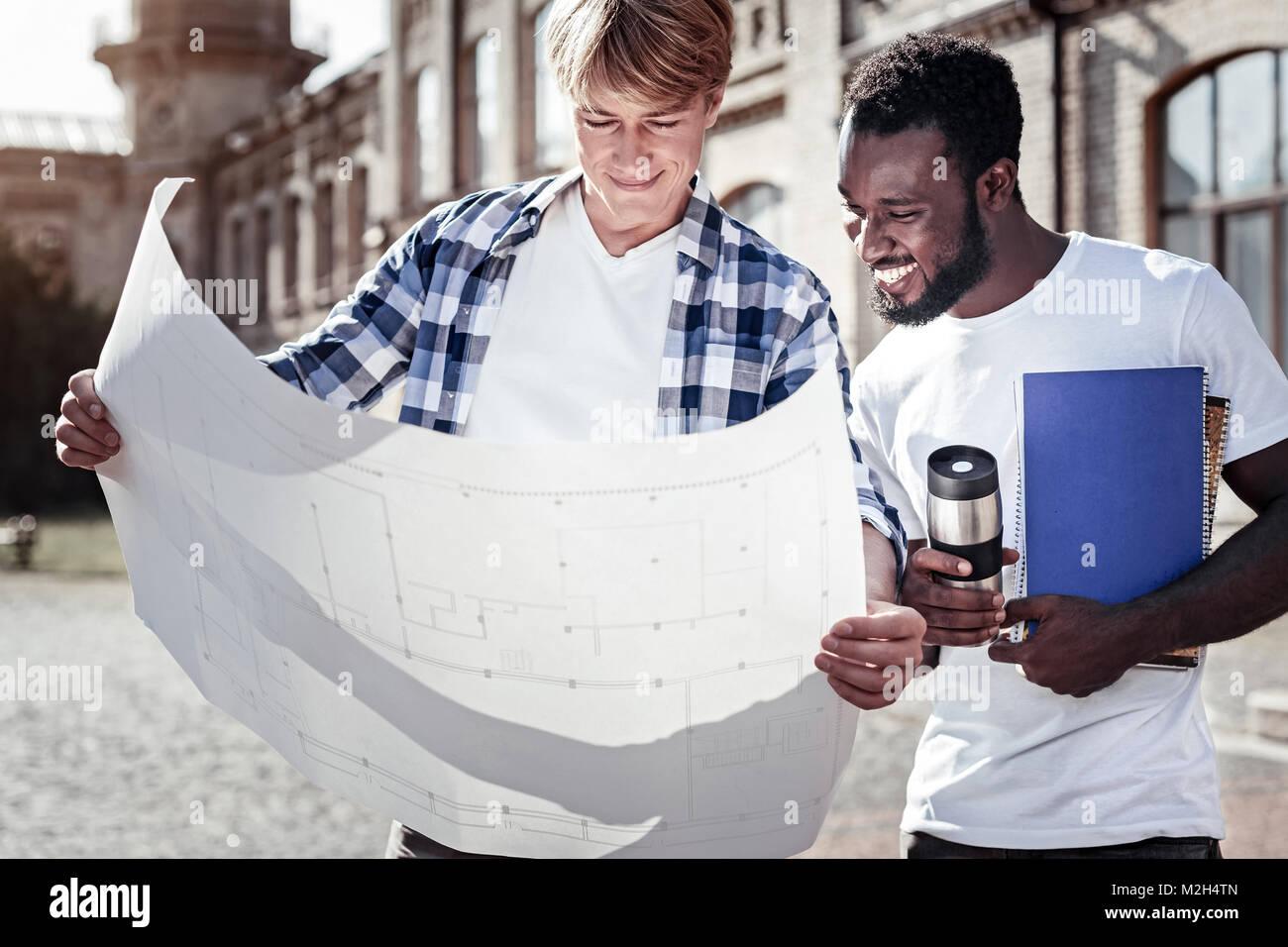 Nice smart students studying the blueprint - Stock Image